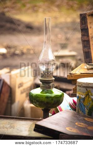 Old paraffin lamp at a flea market close up.