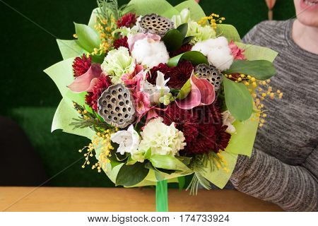 florist girl holding a bouquet of mix flowers