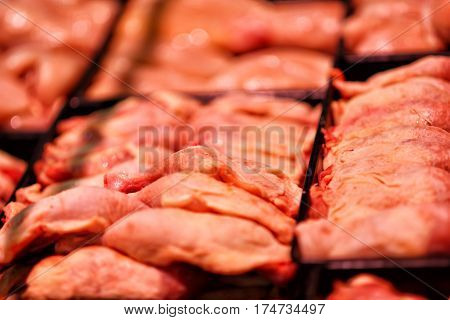 Heap of fresh raw meat food flesh background at shop supermarket.