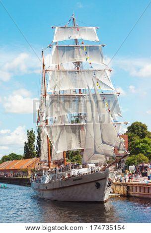KLAIPEDA LITHUANIA - JULY 24 2015: Classic vintage sailboat Meridianas moored in Klaipeda city Lithuania