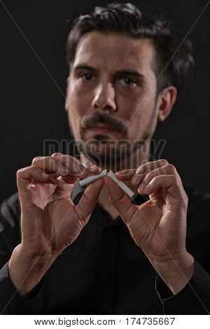 Portrait of adult man who is decided to quit smoking.