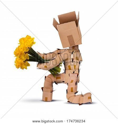 Boxman on bended knee holding bunch of yellow daffodil flowers Isolated on a white background. Flower delivery or gift concept