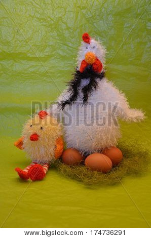 Easter scene with chicken with eggs and chick against yellow background