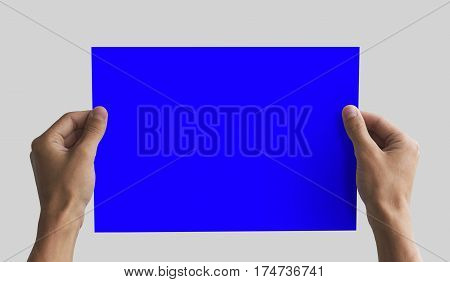 Hand Holding A4 Paper In The Hand. Leaflet Presentation. Pamphlet Hand Man. Man Show Offset Paper. S