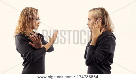 Part of series. Self talk concept. Young woman talking to herself showing gestures. Double portrait from two different side views.