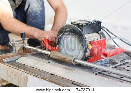 Man Tiler Construction Worker Electric Porcelain Cuts Tiles Tile. Working With Decorative Tile Cutti