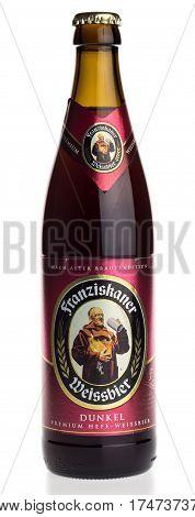 GRONINGEN, NETHERLANDS - FEBRUARY 24, 2017: Bottle of German Franziskaner Dunkel wheat beer, isolated on a white background