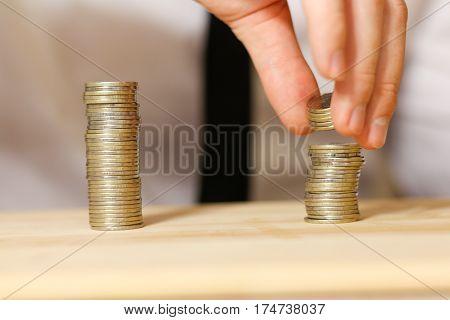 Businessman sharing profit closeup shot. On wooden table