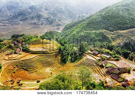 Top View Of Village Houses And Rice Terraces Filled With Water