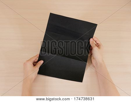 Hands Holding Blank Black Brochure Booklet In The Hand. Leaflet Presentation. Pamphlet Hand Man. Sho