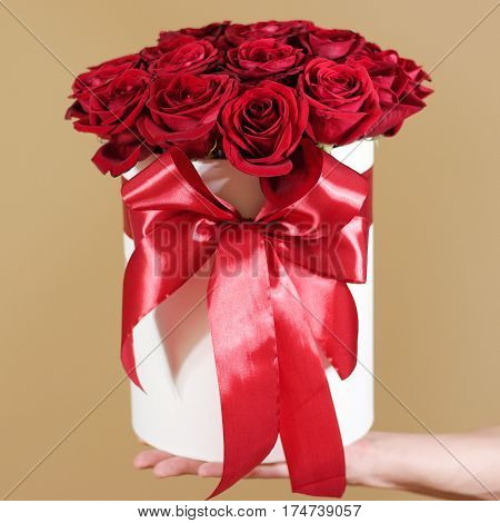 Man Hand Holding Rich Gift Bouquet Of 21 Red Roses. Composition Of Flowers In A White Hatbox. Tied W