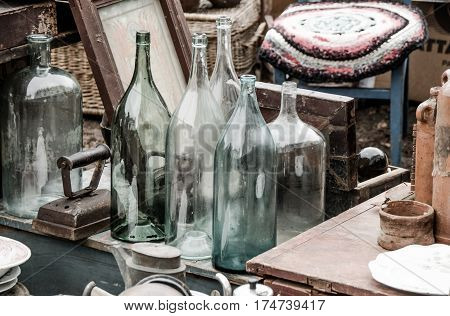 Composition with  vintage bottles and another old things.