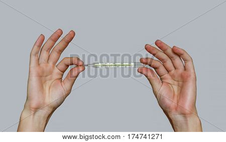 Man Two Hands Holding A Mercury Thermometer And Shows Thumb Up