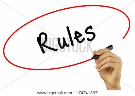 Man Hand Writing Rules With Black Marker On Visual Screen. Isolated On Background. Business, Technol