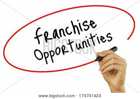 Man Hand Writing Franchise Opportunities With Black Marker On Visual Screen. Isolated On White Backg