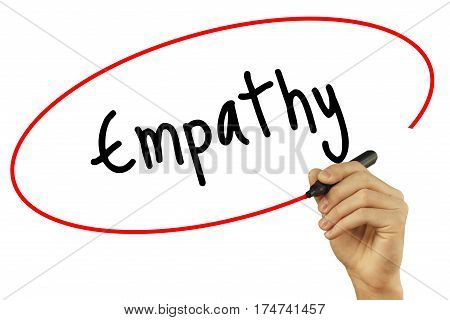 Man Hand Writing Empathy With Black Marker On Visual Screen. Isolated On Background. Business, Techn