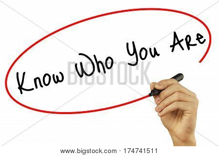 Man Hand Writing Know Who You Are With Black Marker On Visual Screen. Isolated On Background. Busine
