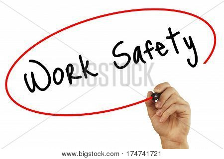 Man Hand Writing Work Safety With Black Marker On Visual Screen. Isolated On Grey. Business, Technol