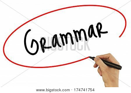 Man Hand Writing Grammar With Black Marker On Visual Screen. Isolated On Background. Business, Techn