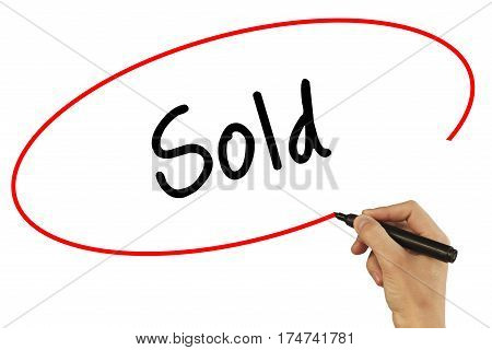 Man Hand Writing Sold With Black Marker On Visual Screen. Isolated On Background. Business, Technolo