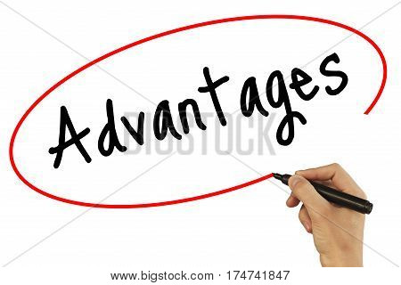 Man Hand Writing Advantages With Black Marker On Visual Screen. Isolated On Background. Business, Te