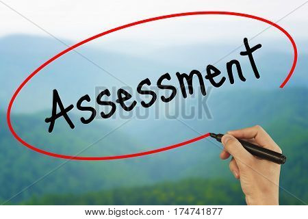 Man Hand Writing Assessment With Black Marker On Visual Screen. Isolated On White. Business, Technol