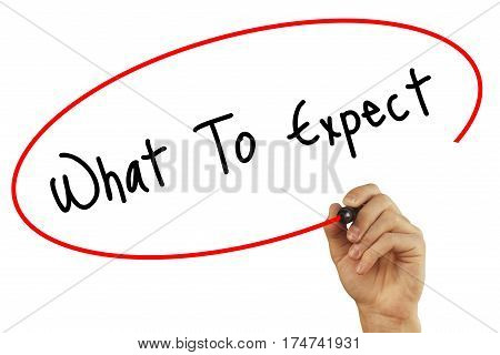 Man Hand Writing What To Expect With Black Marker On Visual Screen. Isolated On Background. Business