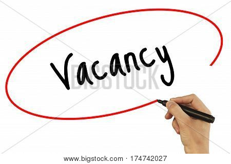 Man Hand Writing Vacancy With Black Marker On Visual Screen. Isolated On Background. Business, Techn