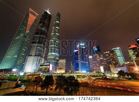 Night View Of Skyscrapers And Other Modern Buildings In Shanghai