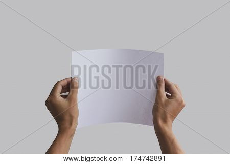 Hand Holding Curved A4 Paper In The Hand. Leaflet Presentation. Pamphlet Hand Man. Man Show Offset P