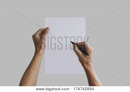 Hand Holding Blank Agreement Mockup And Signing It. Arm Hold Clear Document Template Mock Up. Contra