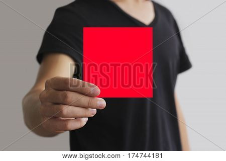 Man Showing Blank Red Square Flyer Brochure Booklet. Leaflet Presentation. Pamphlet Hold Hands. Man