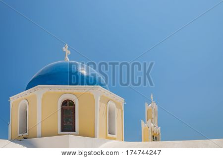 One of the many blue domed churches of Santorini this one located at the back end of Fira.