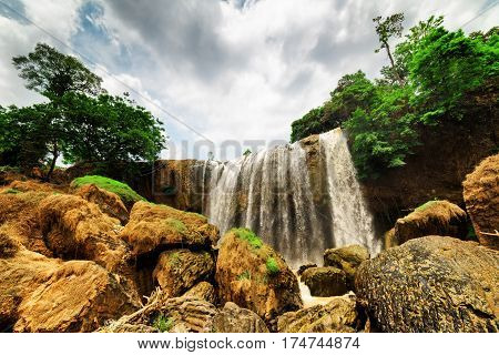 Bottom View Of Waterfall Among Green Woods. Summer Landscape