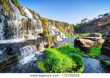 Side View Of Natural Cascading Waterfall With Clear Water
