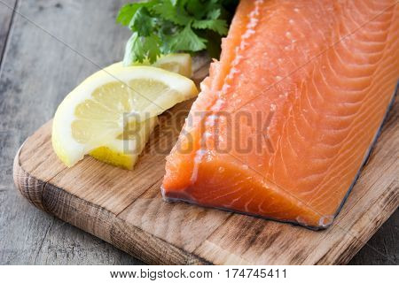 Healthy raw salmon fillet on wooden background