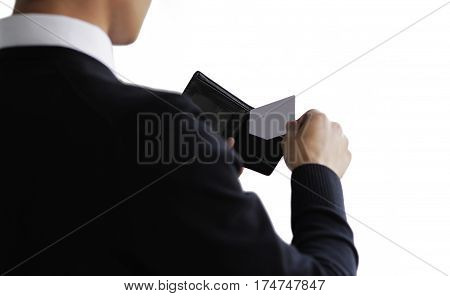Business man taking credit card out of purse