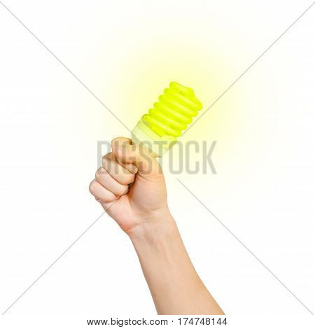 Closeup Of Man's Hand Holding Energy Saving Lamp. Glows Brightly With Yellow Light. Recycling, Elect