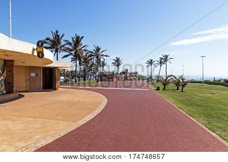Red Paved Promenade On  Beachfront City Landscape