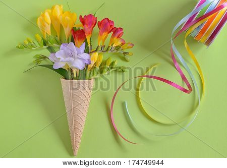 Freesias flowers in ice cream waffles and ribbons