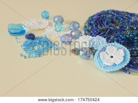 Multicolor beads crochet flowers blue aquamarine gems and cotton yarn. Nice blue dark blue and yellow beads and natural gems. The heap of chains bracelets necklaces