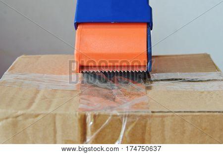 tape dispenser seal brown box on for sending