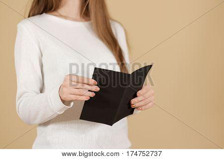 Girl Reading Blank Black Flyer Brochure Booklet. Leaflet Presentation. Pamphlet Hold Hands. Woman Sh