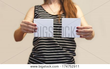Girl Showing Two Blank White Square Flyer Brochure Booklet. Leaflet Presentation. Pamphlet Hold Hand
