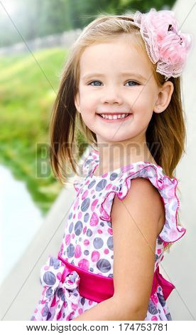 Portrait of adorable little girl in princess dress on summer day