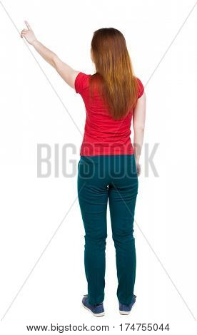 Back view of  pointing. Rear view people collection.  backside view of person.  Isolated over white background. The girl in green pants and shows his hand is the right hand upward.