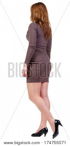 back view of going brunette woman  in brown dress. beautiful girl in motion.  backside view of person. Isolated over white background. Rear view people collection.