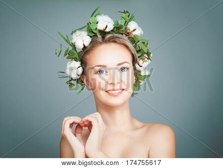 Smiling Spa Model Woman. Healthy Blonde with Fresh Skin and Heart on Blue Banner Background. Health and Bodycare Concept