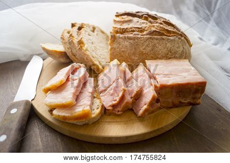 Sliced raw pork meaty bacon on the wooden board