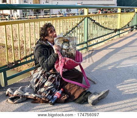 Uzhgorod,ukraine - March 04, 2017: Poor Man Begging For Alms In The Street Of Uzhhorod, Ukraine.